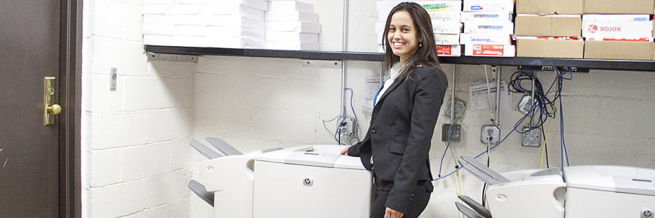 Happy employee by the copy machines